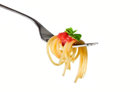 Spaghetti pasta with tomato and basil on fork isolated on white background. Fine Italian food. Professional studio image Stock Photo - 7978342