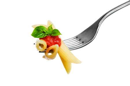 Macaroni pasta with tomato and basil on fork isolated on white background. Fine Italian food. Professional studio image