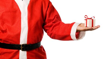 Santa Claus holding a gift on his hand isolated on white background. photo