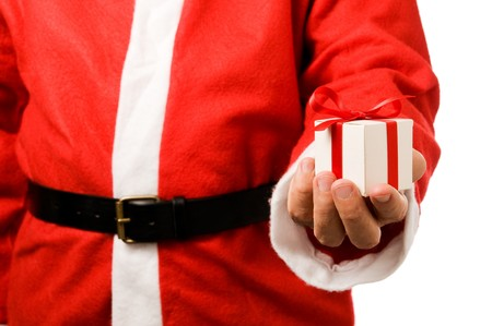 Santa Claus holding and offering a gift on his hand isolated on white background. photo