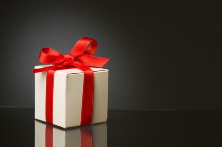 gift packs: Little white box with red ribbon to celebrate a special Christmas Stock Photo
