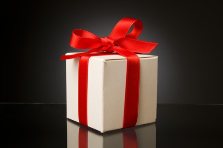 gift packs: Little white box with red ribbon to celebrate a special Christmas, birthday or any kind of holiday!