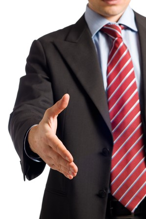 shaking hands business: Businessman in suit giving an hand for handshake to seal the deal