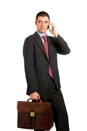 Portrait of young confident businessman with phone and working bag isolated on white background Stock Photo - 7968225