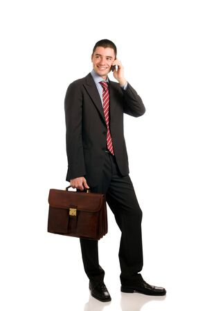 Portrait of young confident businessman with phone and working bag isolated on white background Stock Photo - 7968218