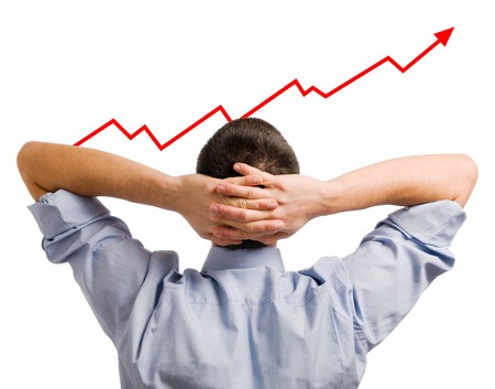 Young businessman looking at his growing share. Healthy and successful business! Stock Photo - 7968260