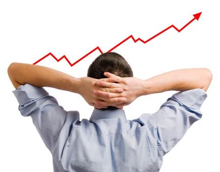 Young Businessman looking at seinen wachsenden Anteil. Gesundes und erfolgreiches Geschäft!