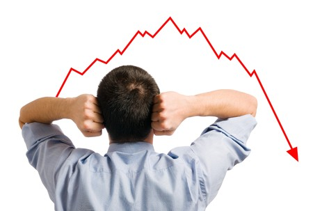 Young businessman looking at his declining share. Bad business, economy in recession!