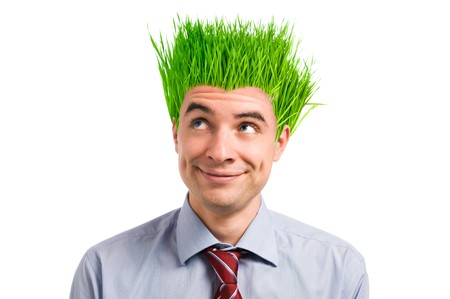 cut grass: Happy young businessman looking up at his new vivid green grass hair. Green business concept