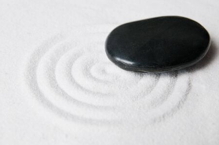 Zen garden pebble detail on a raked white sand photo