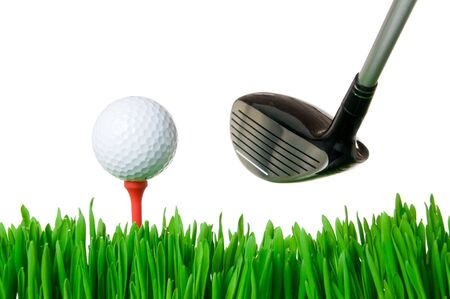 cut grass: Golf ball on tee and a club ready for swinging isolated on white background