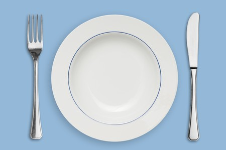 placed: Clean placed plate with fork and knife, ready for dinner! Stock Photo