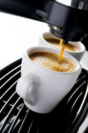 mug shot: Coffee maker pouring hot espresso coffee in two cups. Take your break!