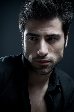 fine art portrait: Handsome latin stylish man looking away. Fine art portrait