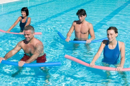 water aerobics: Healthy group of people exercising with aqua tube in a swimming pool