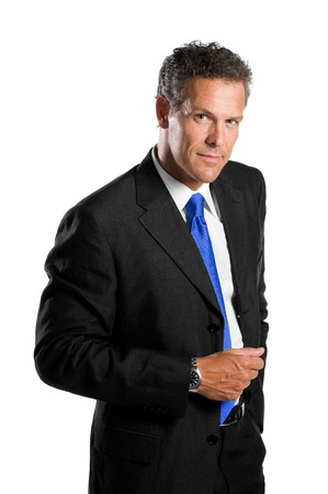 Confident mature businessman standing isolated on white background and looking at camera Stock Photo