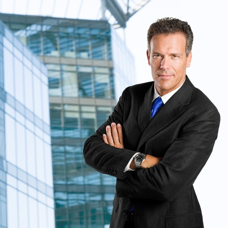 Mature businessman looking at camera with confidence against his office building Stock Photo - 8235385