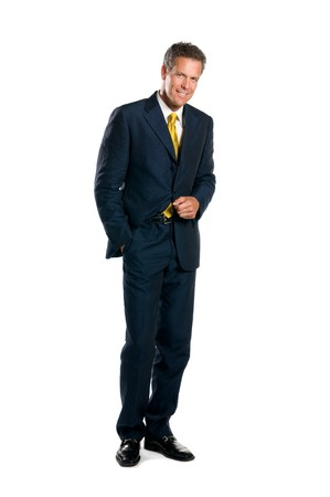 standing alone: Smiling mature businessman standing full length isolated on white background Stock Photo