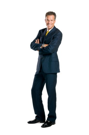 Smiling mature businessman standing full length isolated on white background photo