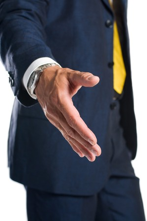 Businessman giving hand for an handshake to seal the agreement photo
