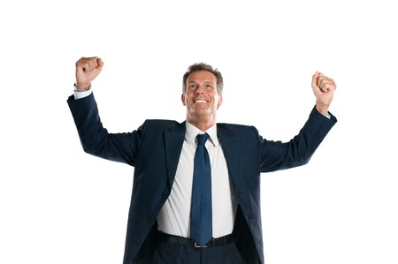 Exultant mature businessman looking up with arms raised isolated on white background photo