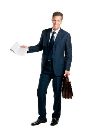 fresh news: Mature businessman standing with a newspaper and briefcase in hand isolated on white background