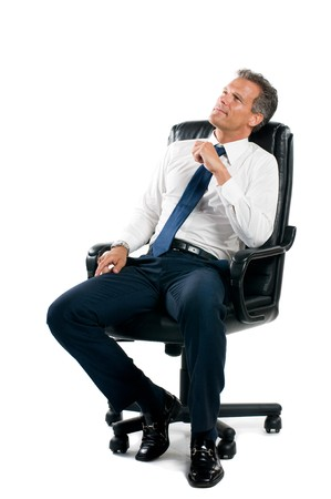 Dreamful pensive businessman sit on his business chair isolated on white background photo