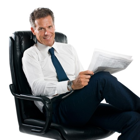 satisfied: Businessman reading news sit in his chair isolated on white background Stock Photo