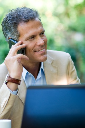 Smiling businessman talking on mobile outdoor Stock Photo - 8235313