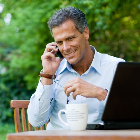 Businessman working outdoor with mobile and laptop Stock Photo - 8235174