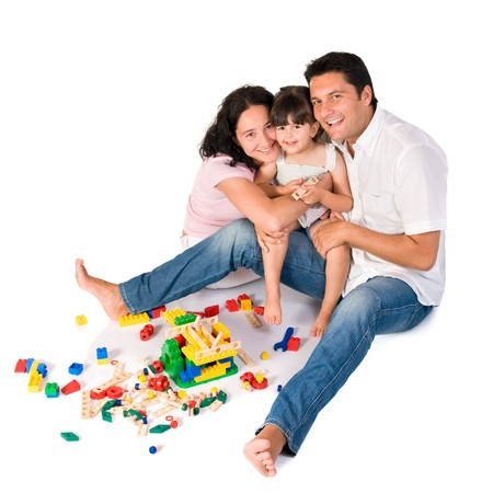 Happy family with parents and daughter playing with colorful blocks isolated on white background photo