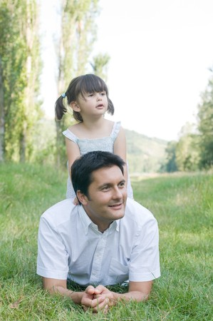intrigued: Father and daughter looking away with curiosity  Stock Photo