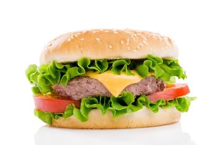 hamburgers: Big fresh delicious hamburger isolated on white background. Professional studio image Stock Photo