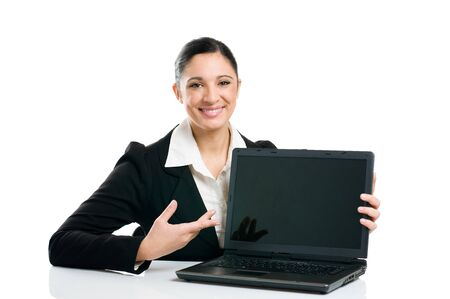 Young business woman showing blank laptop screen ready for your text and promotion, isolated on white background. Stock Photo - 8234808