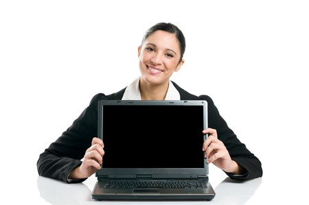 Young business woman showing blank laptop screen ready for your text and promotion, isolated on white background. Stock Photo - 8234679