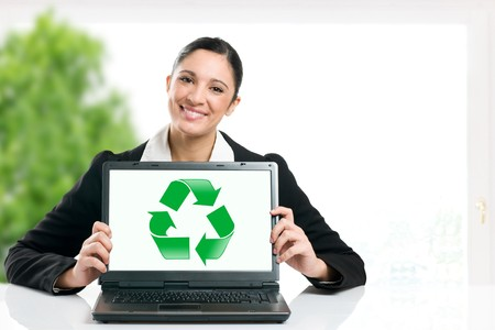 recycle symbol: Business woman showing recycling green symbol in her laptop monitor, copy space for your text Stock Photo