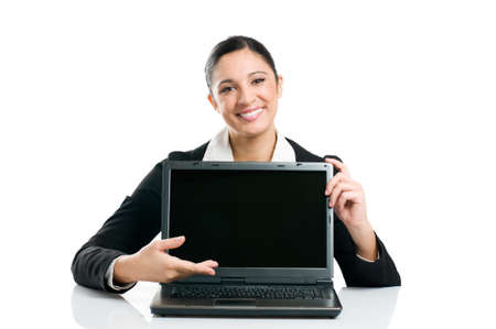 Young business woman showing blank laptop screen ready for your text and promotion, isolated on white background. photo