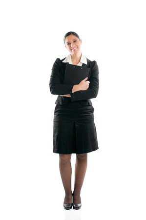 Full length young business woman standing with her clipboard isolated on white background Stock Photo