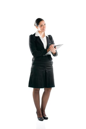 Full length young business woman taking notes on her clipboard isolated on white background photo