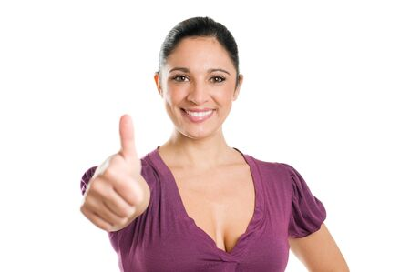 Young beautiful casual woman showing thumb up for her success isolated on white background Stock Photo - 8235113