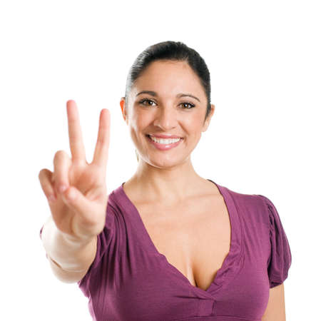 Young casual woman showing victory sign isolated on white background Stock Photo - 8235084