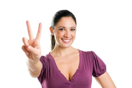 Young casual woman showing victory sign isolated on white background Stock Photo - 8235190