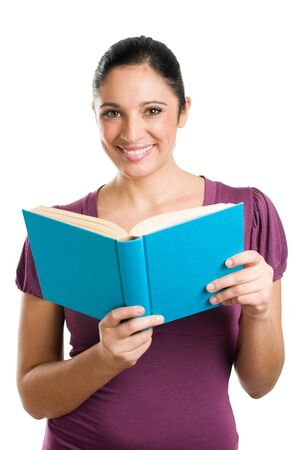 Beautiful young casual woman looking at camera while reading a book isolated on white background Stock Photo - 8235225
