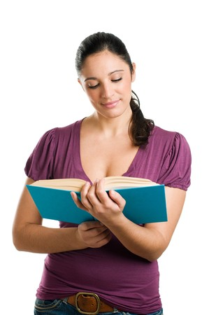Beautiful young casual woman looking down while reading a book Stock Photo - 8235228