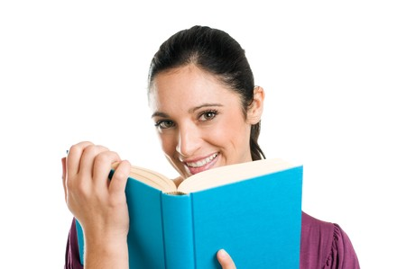 Beautiful young casual woman looking at camera while reading a book isolated on white background Stock Photo - 8235098