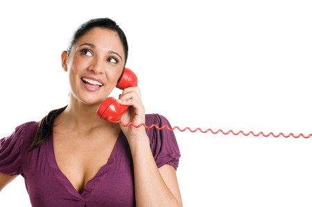 Young casual woman with red receiver dreaming and smiling at the phone call Stock Photo - 8235185