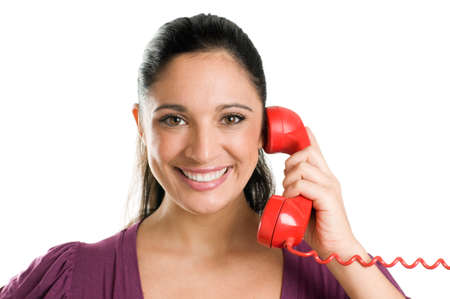 Young casual woman holding a red receiver and smiling at the phone call Stock Photo - 8235193