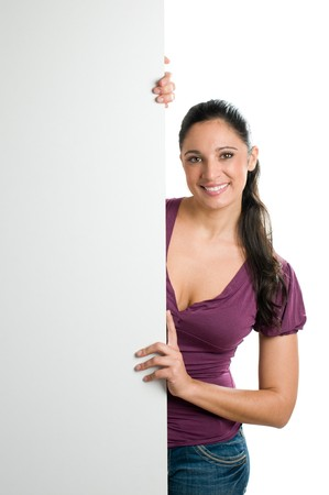 Beautiful smiling young woman holding a blank signboard to write it on whatever you want! Stock Photo - 8235195