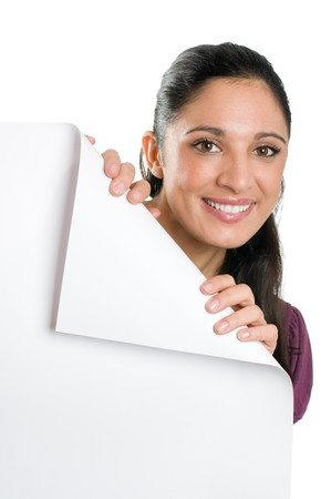 Beautiful smiling young woman looking down on a folded corner of a blank signboard to write it on whatever you want! Stock Photo - 8235095