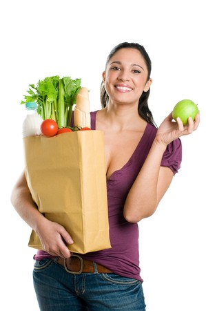 sac �picerie: Young woman holding a grocery bag and showing a fresh apple isolated on white background